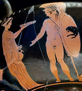 Cassandra (on the left) offering a libation while her brother Hector (on the right) prepares to go to battle. Attic red-figure kantharos by the Eretria Painter, ca. 425–420 BC.  Wikimedia